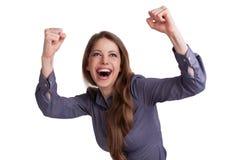 La mujer aumentó entusiasta sus manos para arriba Imagen de archivo libre de regalías