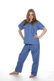 La mujer bonita en médico azul friega Imágenes de archivo libres de regalías