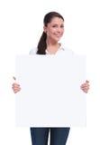 La mujer casual sostiene una bandera Fotografía de archivo