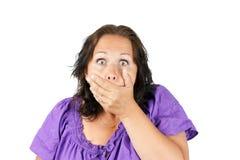 La mujer chocada con entrega la boca Foto de archivo libre de regalías
