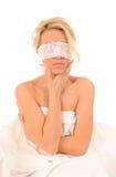 La mujer con el cordón sujetó en ojos Imágenes de archivo libres de regalías