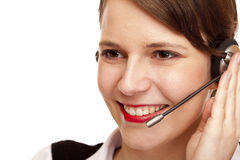 La mujer con el receptor de cabeza ríe feliz y hace una llamada Imágenes de archivo libres de regalías