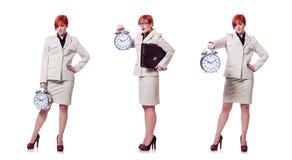 La mujer con el reloj aislado en blanco foto de archivo libre de regalías