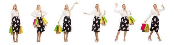 La mujer con los panieres aislados en blanco foto de archivo libre de regalías