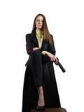 La mujer con un arma Imagen de archivo libre de regalías