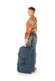 La mujer con una maleta da vuelta alrededor Imagenes de archivo