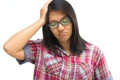 La mujer consiguió un dolor de cabeza Fotografía de archivo libre de regalías
