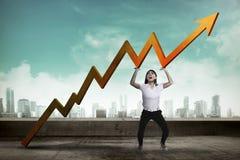 La mujer de negocios asiática aumenta para arriba la carta de las ventas Imagen de archivo