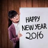 La mujer de negocios asiática escribe la Feliz Año Nuevo 2016 Foto de archivo