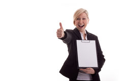La mujer de negocios con una libreta levanta el pulgar Imagen de archivo libre de regalías
