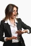 La mujer de negocios elegante es ya atrasada Imagen de archivo libre de regalías