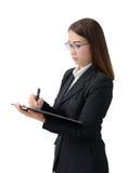 La mujer de negocios escribe en el tablero Imagenes de archivo