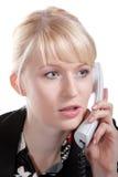 La mujer de negocios joven habla por el teléfono Imágenes de archivo libres de regalías