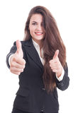 La mujer de negocios larga atractiva del pelo que muestra el doble tiene gusto Imágenes de archivo libres de regalías