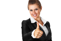 La mujer de negocios moderna sonriente que muestra los pulgares sube la GE Fotos de archivo libres de regalías