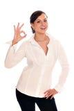 La mujer de negocios muestra una autorización de la muestra Foto de archivo libre de regalías