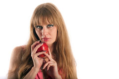 La mujer de pelo largo con una manzana Imagenes de archivo