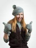 La mujer del éxito manosea con los dedos para arriba Fotografía de archivo