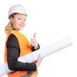 La mujer del ingeniero manosea con los dedos para arriba Imagen de archivo