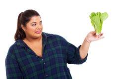 La mujer odia lechuga Imagenes de archivo