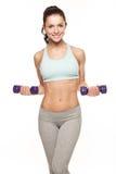 La mujer deportiva hace su entrenamiento con pesas de gimnasia Fotos de archivo libres de regalías