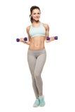 La mujer deportiva hace su entrenamiento con pesas de gimnasia Fotografía de archivo libre de regalías