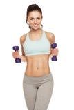 La mujer deportiva hace su entrenamiento con pesas de gimnasia Fotografía de archivo