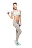 La mujer deportiva hace su entrenamiento con pesas de gimnasia Imágenes de archivo libres de regalías