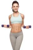 La mujer deportiva hace su entrenamiento con pesas de gimnasia Imagen de archivo libre de regalías