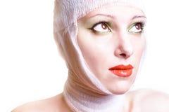 La mujer después de la operación plástica Imágenes de archivo libres de regalías