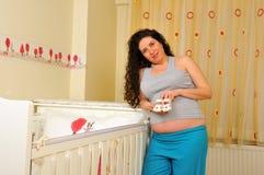 La mujer embarazada Foto de archivo