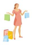 La mujer embarazada con las compras Imagen de archivo