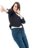La mujer emocionada que muestra los pulgares sube gesto imagen de archivo