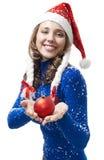 La mujer en traje del Año Nuevo da la bola roja Fotografía de archivo