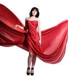 La mujer en una alineada roja Foto de archivo libre de regalías
