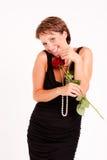 La mujer encantadora con rojo se levantó Imágenes de archivo libres de regalías