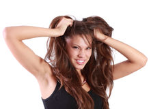 La mujer enojada joven rasga su pelo Foto de archivo