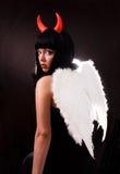 La mujer es un ángel y un diablo Fotos de archivo libres de regalías