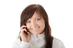 La mujer está llamando con un móvil Imágenes de archivo libres de regalías