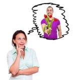 La mujer está pensando en un hombre con las flores foto de archivo
