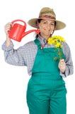 La mujer feliz atractiva vistió al jardinero Fotos de archivo