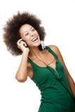La mujer feliz escucha música Fotografía de archivo libre de regalías