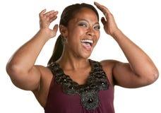 La mujer feliz fija su pelo Imagenes de archivo