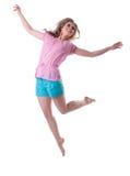La mujer feliz salta y sonríe Foto de archivo libre de regalías