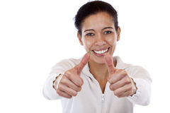 La mujer feliz, sonriente muestra ambos pulgares para arriba Fotos de archivo
