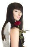 La mujer hermosa del ángel con se levantó Foto de archivo libre de regalías