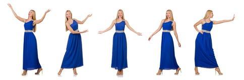 La mujer hermosa en el vestido azul largo aislado en blanco Imagenes de archivo
