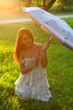 La mujer hermosa joven Foto de archivo