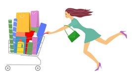 La mujer hermosa joven rueda el carro de la compra lleno Fotografía de archivo libre de regalías