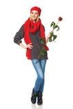 La mujer hermosa que llevaba a cabo rojo se levantó Fotografía de archivo libre de regalías
